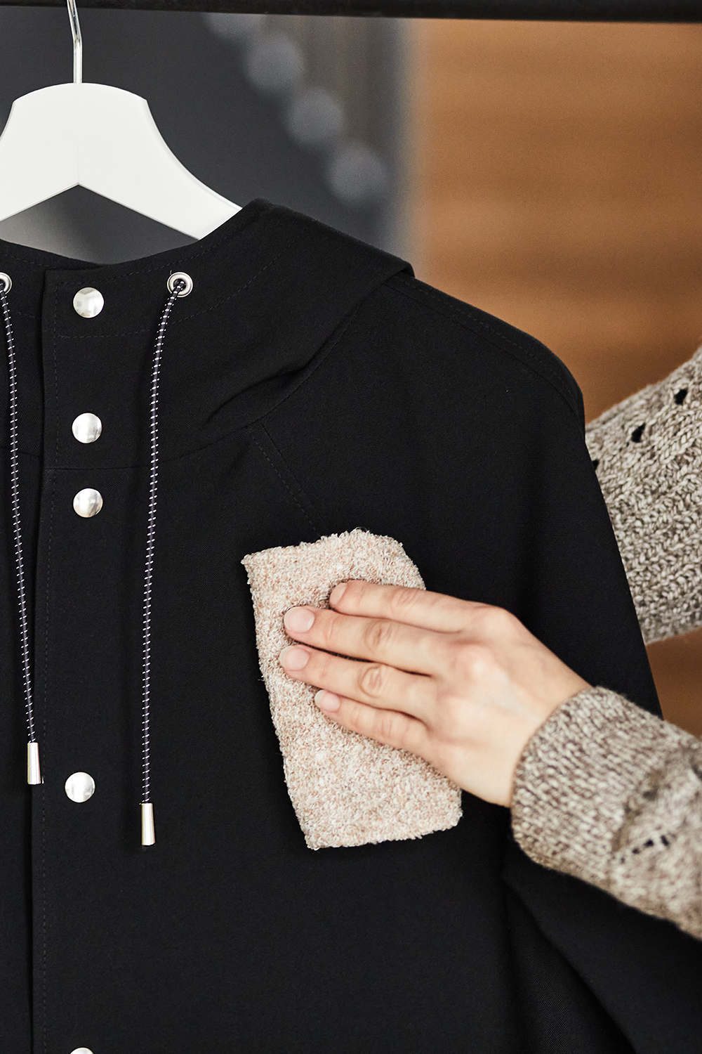 clean your raincoat with a damp cloth